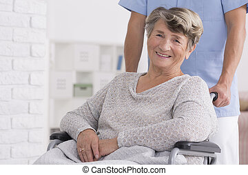 Smiled senior woman with her caregiver - Smiled senior woman...