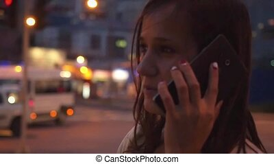 Smiles beautiful businesswoman use mobile phone in city at night street