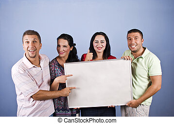 Smiles people against blank banner - Smiles people holding a...