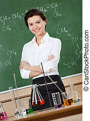 Smiley chemistry teacher with crossed arms