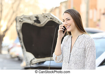 Smiley driver calling insurance after car breakdown