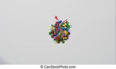 Smiley face made of pins and clips - Mix of colorful paper...