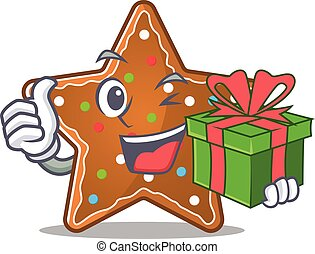 Smiley gingerbread star character with gift box
