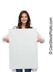 Smiley girl handing copyspace - Half-length portrait of...