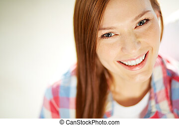 Smiley girl - Happy teenage girl looking at camera with...