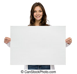 Smiley girl keeping copyspace - Half-length portrait of...