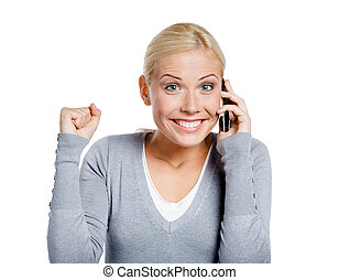 Smiley girl speaking on phone with her fist up, isolated on...