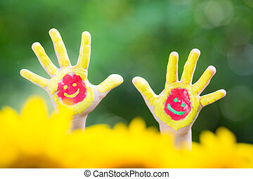 Smiley hands against green spring background
