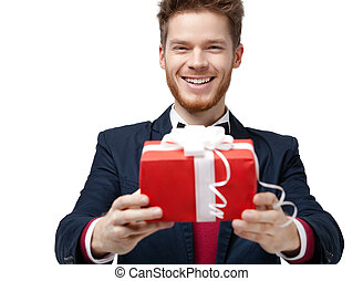 Smiley handsome man offers a gift
