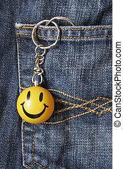 Smiley Keyring - Smiley keyring hanging from denin jeans...
