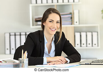 Smiley office worker posing looking at camera