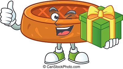 Smiley peanut cookies cartoon character holding a gift box