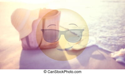 Smiley with sunglasses on the beach