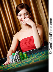 Smiley woman at the roulette table