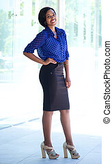 Smiling african american business woman standing outside