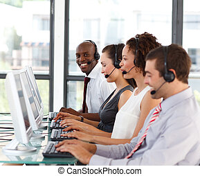 Smiling African-American businessman in a call center