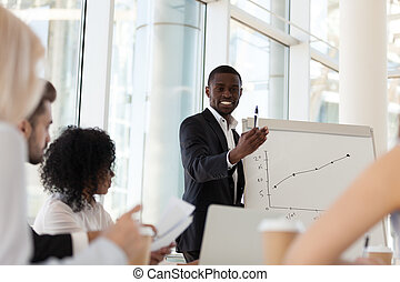 Smiling African American coach give flipchart presentation to em