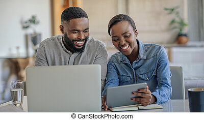 Smiling African American couple working on their household finances together