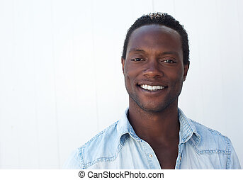 Smiling african american face against white background