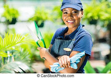 african american gardener holding garden tool