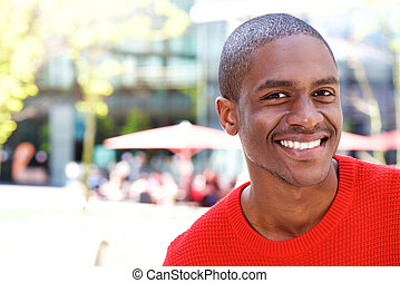 Smiling african american man in the city