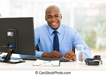 african american office worker looking at the camera