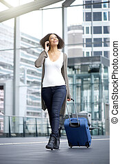 Smiling african american travel woman