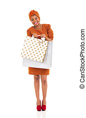 african american woman carrying two shopping bags