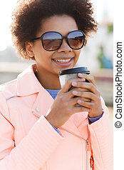 smiling african american woman drinking coffee