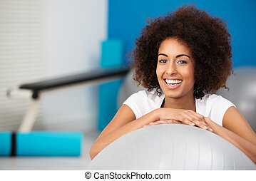 Smiling African American woman in a gym