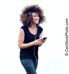 Smiling african american woman listening to music on headphones