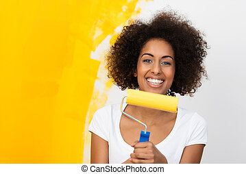 Smiling African American woman redecorating
