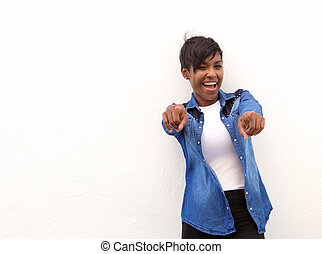 Smiling african american woman pointing fingers