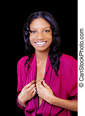 Smiling African American Woman Standing Against Black Background