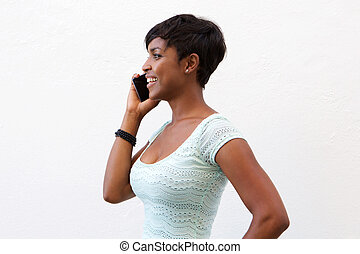 Smiling african american woman talking on cell phone