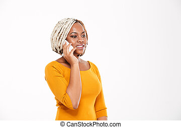 Smiling african american woman talking on mobile phone