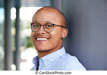 Smiling african businessman with glasses