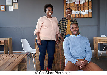 Smiling African colleagues working together in a modern office