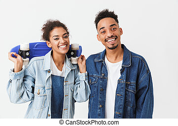 Smiling african couple in denim shirts posing together