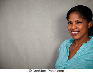 Smiling african lady looking at the camera