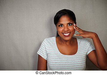 Smiling african woman looking at the camera