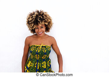 Smiling african woman standing against white background