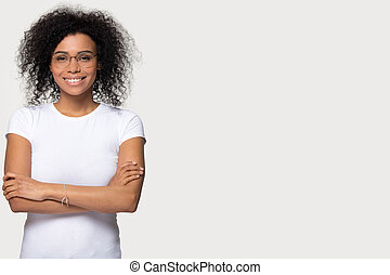 Smiling african woman standing isolated on white background with copyspace