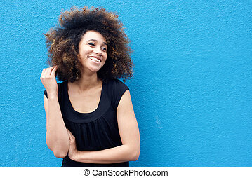 Smiling african woman with afro hairstyle
