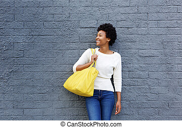 Smiling african woman with bag