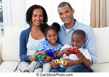 Smiling Afro-american family with children living-room