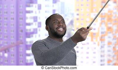 Smiling afro-american guy taking selfie. Cheerful...