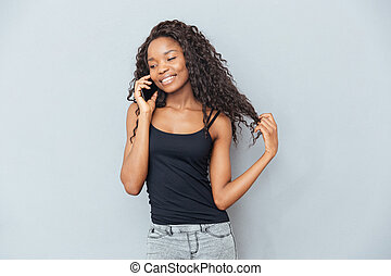 Smiling afro american woman talking on the phone
