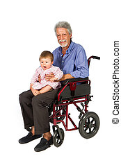 Smiling aged man patient in a wheelchair