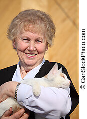 Smiling aged woman with cat